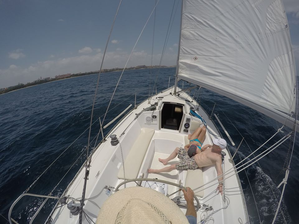 Picture of two guests relaxing in the cockpit of sailboat during a daysail.