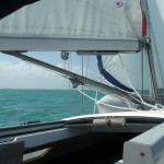 Picture of boat sailing on Caribbean water.
