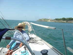 Picture of Bastian Sarh sailing into San Juan harbor on sailboat.
