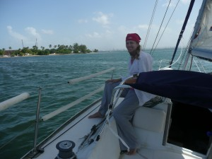 Picture of girl with bandana sitting on sailboat coming into San Juan Puerto Rico.