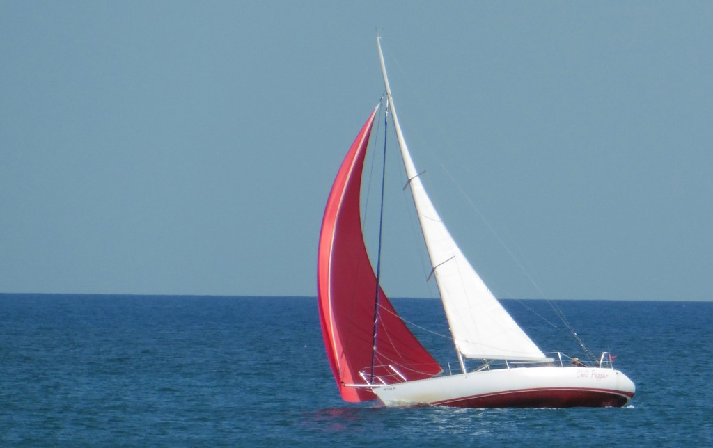 Picture of asymmetrical spinnaker on Chili Pepper, a Beneteau sailboat.