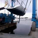 Picture of boat being lowered into water.