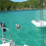 Picture of girl swimming off sailboat in St John, US Virgin Islands.